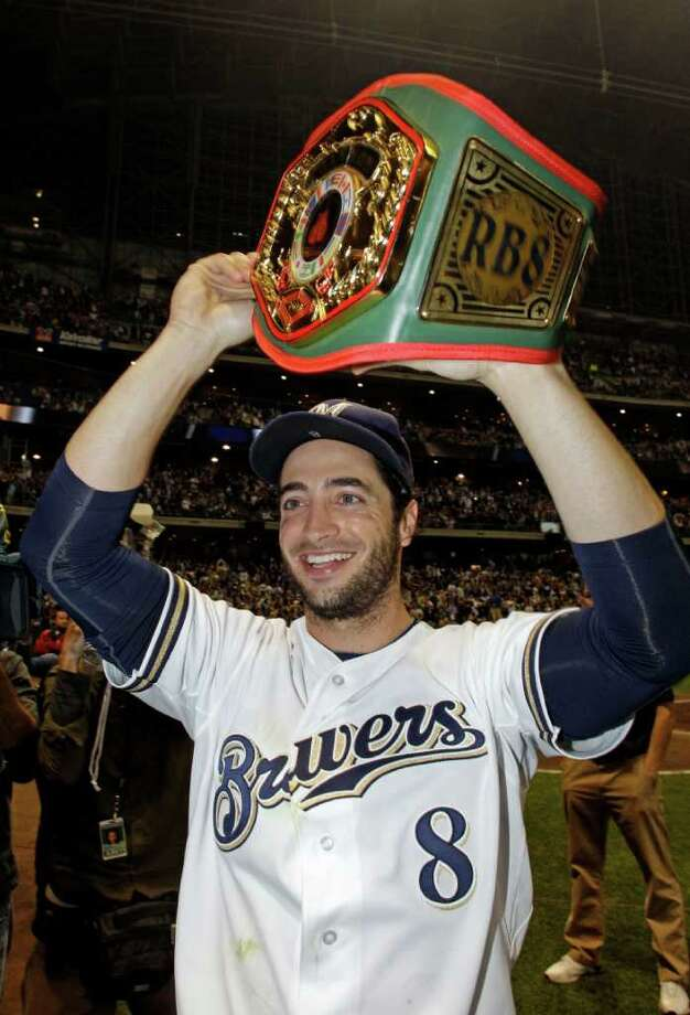 Milwaukee Brewers' Ryan Braun holds up a championship belt after a baseball game against the Florida Marlins, Friday, Sept. 23, 2011, in Milwaukee. The Brewers clinched a NL Central title with a 4-1 win over the Marlins. (AP Photo/Morry Gash) Photo: Morry Gash, Associated Press / AP