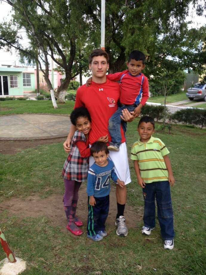 Jack Freiheit, 16, poses with Guatemalan children in Villa Nueva, a suburb of Guatemala City. Photo: Contributed Photo