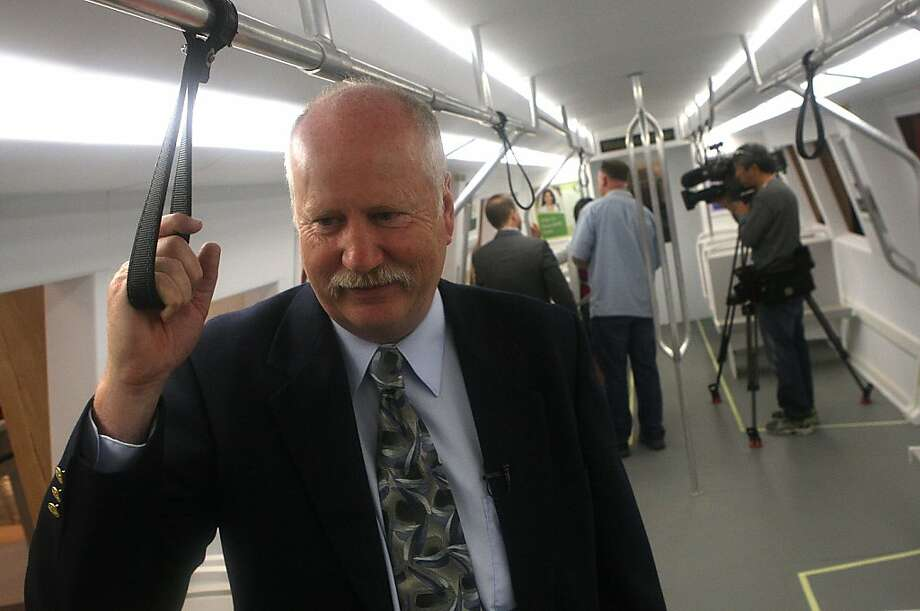 "The ""Fleet of the Future"" model train car shown by project director John Garnham at a media preview at MacArthur Bart station in Oakland, Calif., on Monday, July 22, 2013.   The preview of Bart's ""Fleet of the Future"" model train car will be open for public viewing from Tuesday to Friday. Photo: Liz Hafalia, The Chronicle"