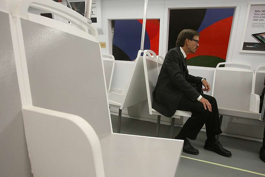 "The ""Fleet of the Future"" model train car has seat partitions at MacArthur Bart station in Oakland, Calif., on Monday, July 22, 2013.   The preview of Bart's ""Fleet of the Future"" model train car will be open for public viewing from Tuesday to Friday. Photo: Liz Hafalia, The Chronicle"