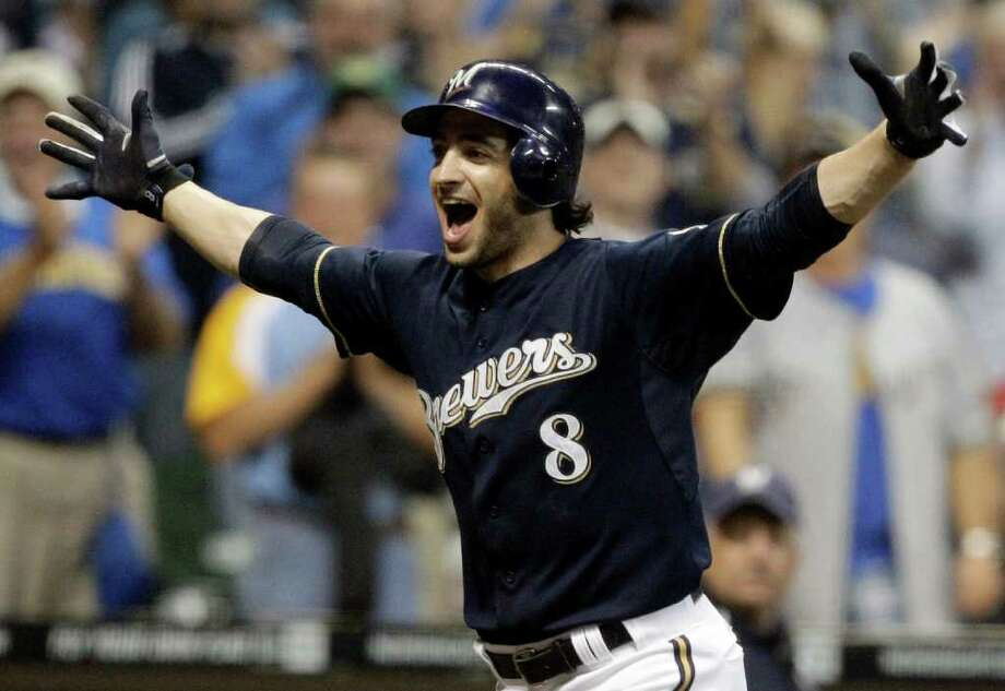 In this Sept. 13, 2011 file photo, Milwaukee Brewers' Ryan Braun reacts after hitting a game-winning home run during the 11th inning of a baseball game against the Colorado Rockies, in Milwaukee. Braun won the National League MVP Award that year. Photo: Morry Gash