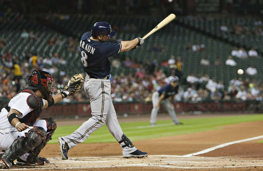 Ryan Braun #8 of the Milwaukee Brewers doubles in the first inning scoring Nyjer Morgan #2 of the Milwaukee Brewers against the Houston Astros at Minute Maid Park on August 10, 2012 in Houston, Texas.  (Bob Levey / Getty Images)