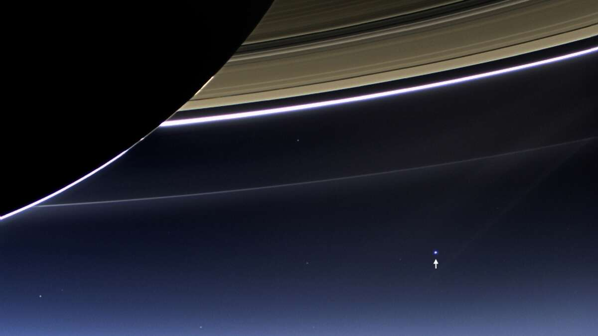 Now on to other images of Earth published by NASA over the decades: In this rare image taken on July 19, 2013, the wide-angle camera on NASA's Cassini spacecraft has captured Saturn's rings and our planet Earth and its moon in the same frame. It is only one footprint in a mosaic of 33 footprints covering the entire Saturn ring system (including Saturn itself). At each footprint, images were taken in different spectral filters for a total of 323 images: some were taken for scientific purposes and some to produce a natural color mosaic. This is the only wide-angle footprint that has the Earth-moon system in it. The dark side of Saturn, its bright limb, the main rings, the F ring, and the G and E rings are clearly seen; the limb of Saturn and the F ring are overexposed. The
