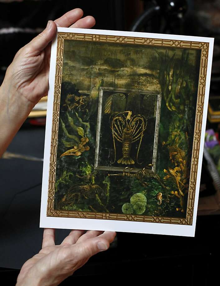 """Jane Richardson Mack looks at her verre églomisé painting called """"The Lady and the Lobster"""" at her home studio in Fairfax. Photo: Lacy Atkins, The Chronicle"""