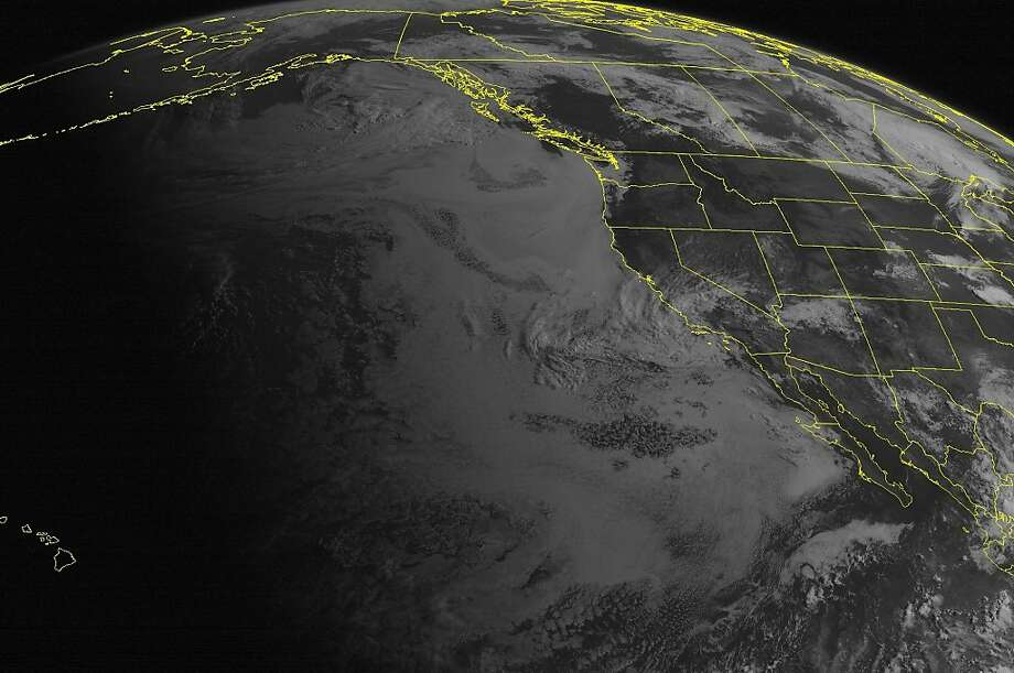 This NOAA satellite image taken Monday, July 22, 2013, at 11:00 a.m. EDT shows generally fair skies across much of the Western US with the exception of central and southwestern California, where clouds and rain showers are occurring. Some clouds are occurring over northern Arizona with some rain showers and an isolated thunderstorm. a Storm system over southwestern Ontario is generating some clouds and showers over the Northern Plains and Upper Mississippi Valley. (AP PHOTO/WEATHER UNDERGROUND) Photo: Associated Press