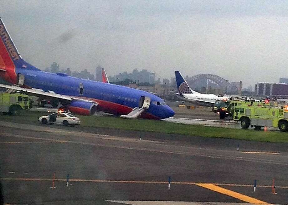 A Southwest Airlines plane sits on a runway after its accident at New York's LaGuardia Airport. Photo: Jared Rosenstein, Associated Press