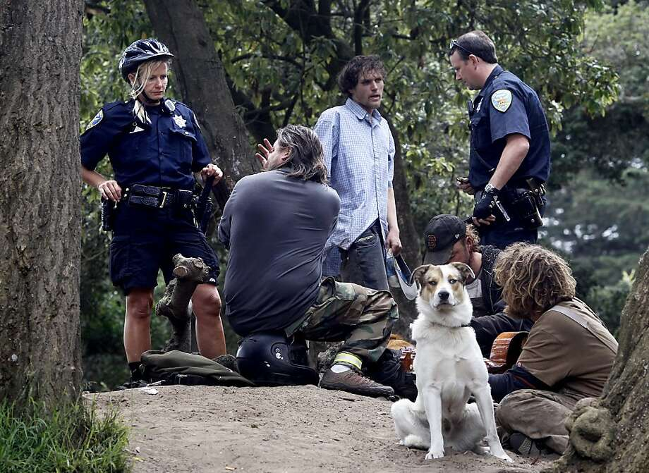 Police issue tickets for public drinking on the east end of Golden Gate Park, which has no official closing time. Photo: Brant Ward, The Chronicle