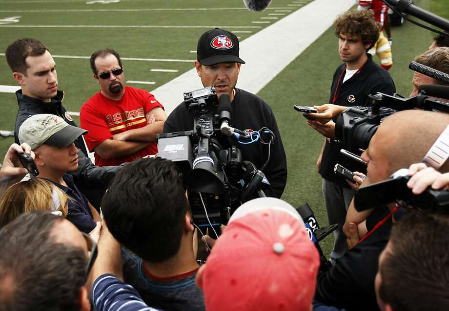 49ers head coach Jim Harbaugh talks with the media Monday. The full training camp opens Wednesday. Photo: Rohan Smith, The Chronicle