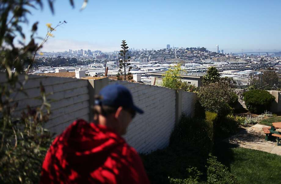 The S.F. skyline is visible as neighborhood resident Bryan Schepp stands in a park atop Mount St. Joseph. Photo: Pete Kiehart, The Chronicle