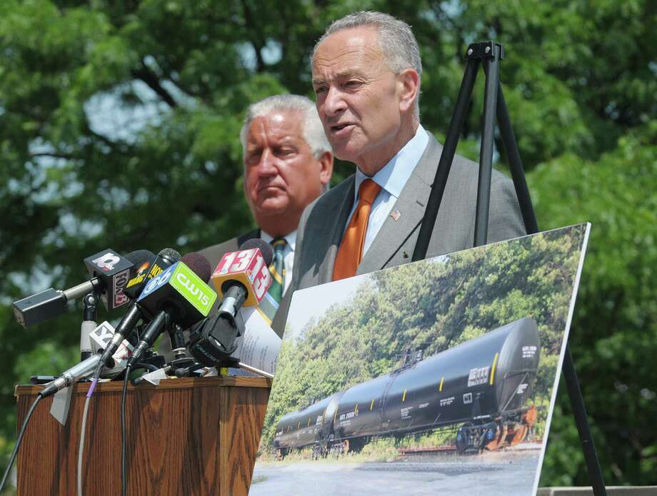 Albany Mayor Jerry Jennings, left, and U.S. Senator Charles Schumer take part in a press conference Monday, July 22, 2013, in Albany, N.Y.  Senator Schumer announced that he is calling on USDOT to require freight railroads to phase out or retrofit DOT-111 tank cars. (Paul Buckowski / Times Union) Photo: Paul Buckowski / 00023247A