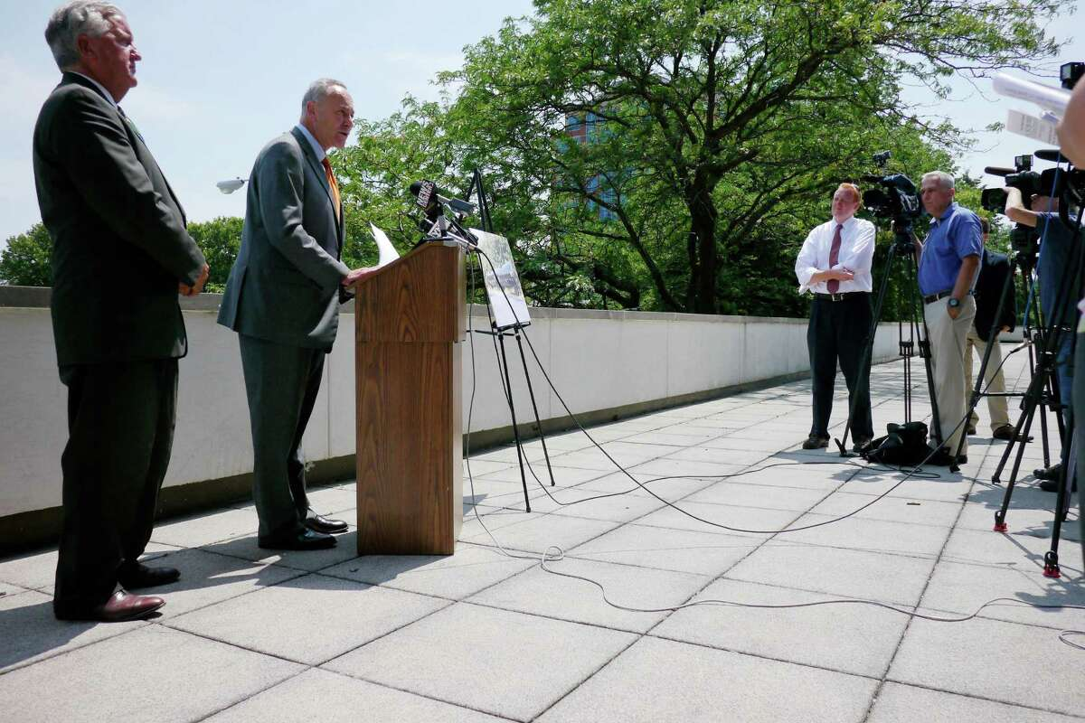 Albany Mayor Jerry Jennings, left, and U.S. Senator Charles Schumer take part in a press conference Monday, July 22, 2013, in Albany, N.Y. Senator Schumer announced that he is calling on USDOT to require freight railroads to phase out or retrofit DOT-111 tank cars. (Paul Buckowski / Times Union)