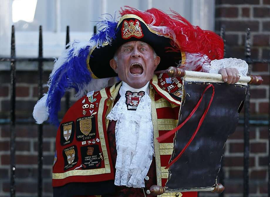 Tony Appleton, a town crier,  announces the birth of the royal baby, outside St. Mary's Hospital exclusive Lindo Wing in London, Monday, July 22, 2013. Palace officials say Prince William's wife Kate has given birth to a baby boy. The baby was born at 4:24 p.m. and weighs 8 pounds 6 ounces. The infant will become third in line for the British throne after Prince Charles and William. (AP Photo/Lefteris Pitarakis) Photo: Lefteris Pitarakis, Associated Press