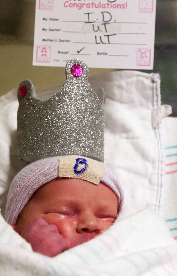 Newborn baby Sawyer Kay Wendt who weighs 6 lbs, 5oz gets the royal treatment with wearing her very own crown at Children's Memorial Hermann Hospital on Monday, July 22, 2013, in Houston.   The hospital provided goodie bags and treats for babies that were born on the same day as the royal baby. Photo: J. Patric Schneider, For The Chronicle / © 2013 Houston Chronicle