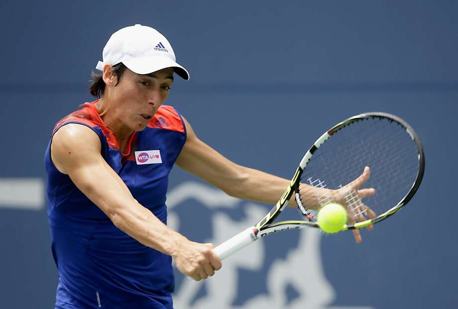 Francesca Schiavone returns a shot to Mallory Burdette at Stanford's Taube Stadium. Photo: Ezra Shaw, Getty Images