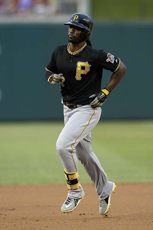Andrew McCutchen, right, hit two-run homers in his first two at-bats in the Pirates' 6-5 win over the Nationals on Monday night in Washington. Photo: Patrick McDermott, Getty Images