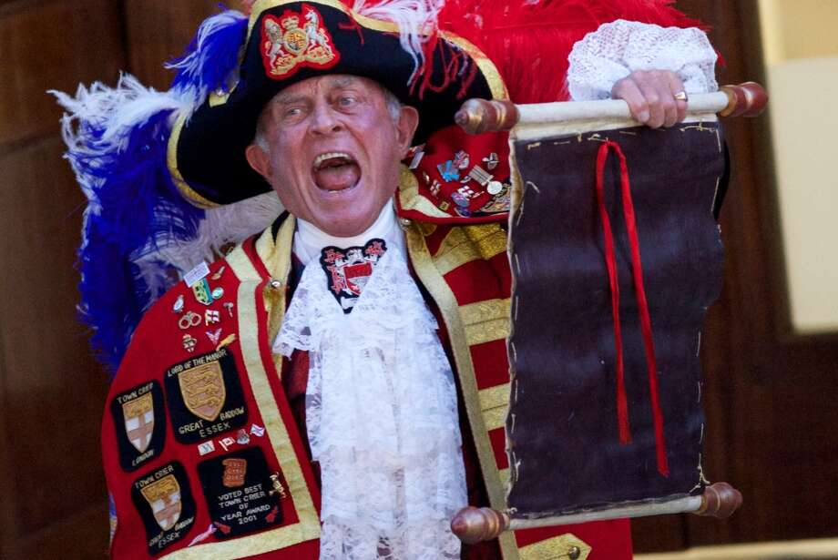 A Town Crier reads an announcement about the birth of the newest member of England's royal family on Monday, July 22, 2013.