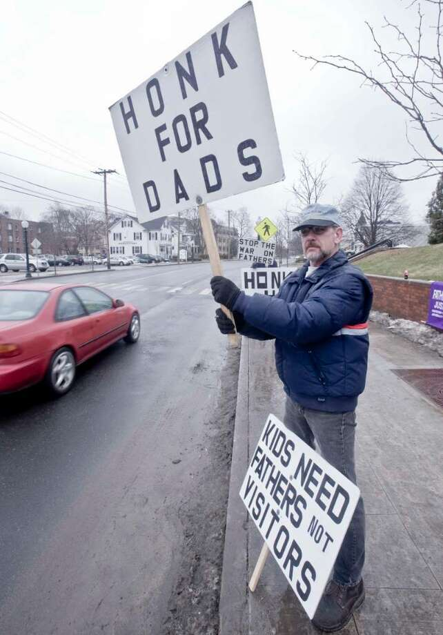 Joe Neverisky of Danbury protesting in front of the Superior Court building to advocate for more rights for fathers in divorce situatons. They say the system is biased towards women. Tuesday, Jan. 19, 2010 Photo: Scott Mullin / The News-Times