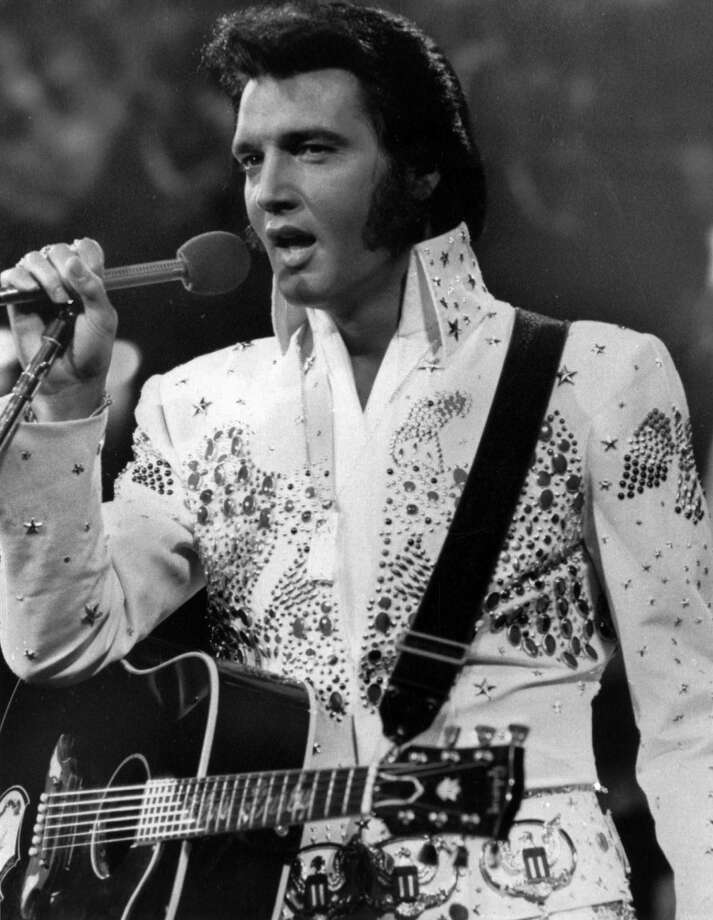 American singer Elvis Presley, shown in concert in the later part of his career, was known as the King of Rock. His life starting from a poor childhood in Mississippi to the top of the music world to his death at age 42 made him one of the cultural icons of the 20th century.