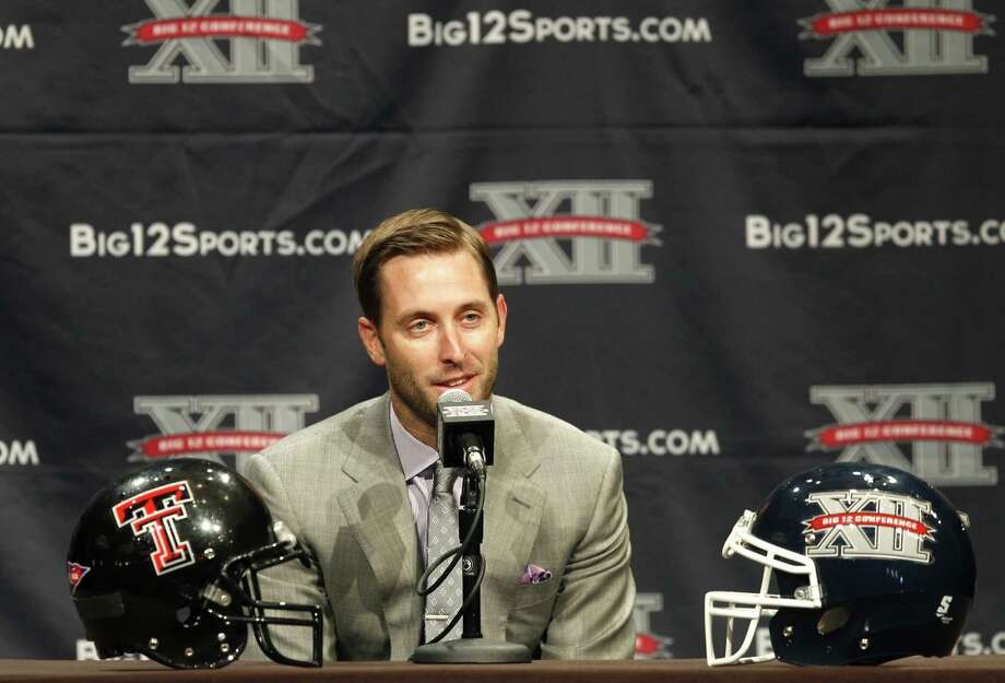 Texas Tech's Kliff Kingsbury speaks to reporters in Dallas. The 33-year-old said returning to his alma mater has been worth the extra work that comes with his first head-coaching job. Photo: Tim Sharp / Associated Press