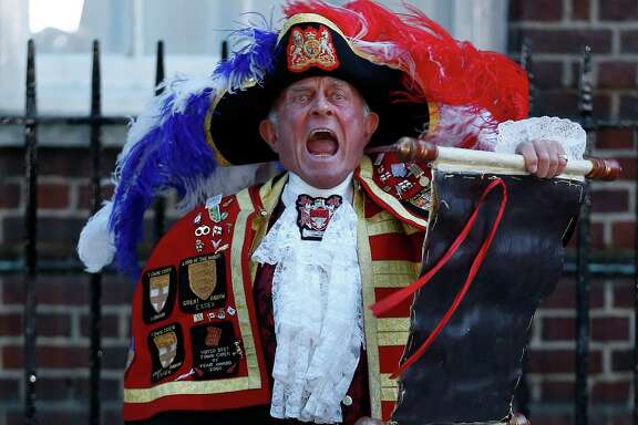 Tony Appleton, a town crier,  announces the birth of the royal baby boy Monday, outside St. Mary's Hospital exclusive Lindo Wing in London.