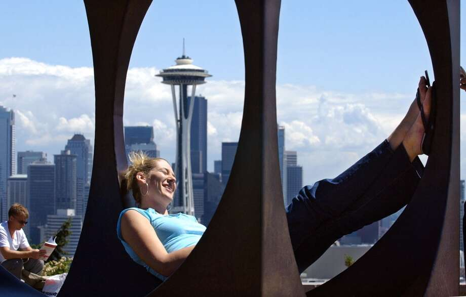 Love: Luxurious summers without infernal heat that makes you want to crawl inside and immediately collapse in front of a fan. (Photo: Seattle Storm's Lauren Jackson at Kerry Park).