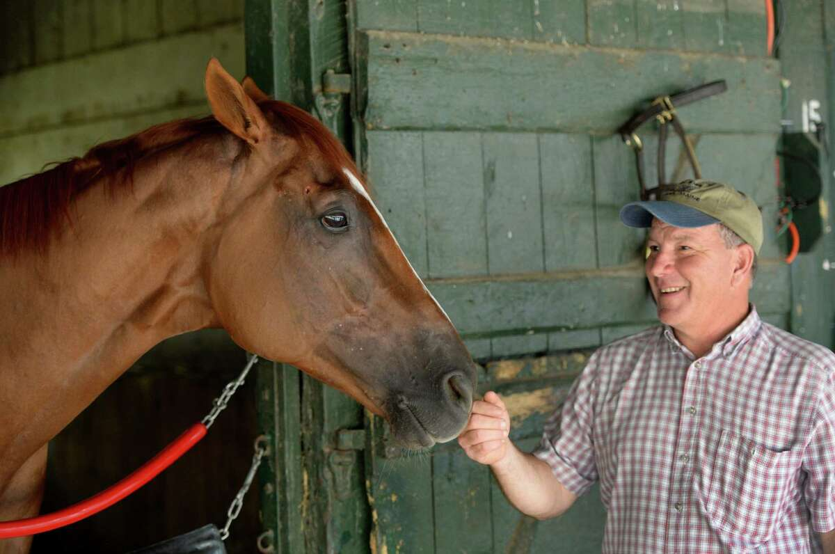Champion Wise Dan spends a moment with his trainer Charley LoPresti, right, Monday morning, July, 22, 2013, at Saratoga Race Course in Saratoga Springs, N.Y. (Skip Dickstein/Times Union)