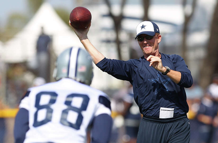 Head coach Jason Garrett throws the ball to receiver Dez Bryant (88) during the afternoon session of the 2013 Dallas Cowboys training camp on Monday, July 22, 2013 in Oxnard. Photo: Kin Man Hui, San Antonio Express-News / ©2013 San Antonio Express-News