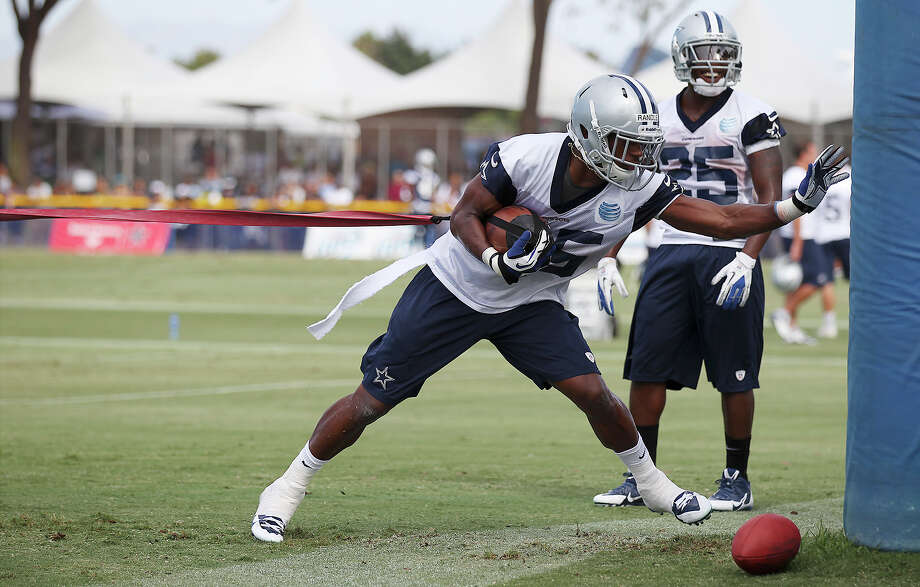 Running back Joseph Randle (35) performs a drill during the afternoon session of the 2013 Dallas Cowboys training camp on Monday, July 22, 2013 in Oxnard. Photo: Kin Man Hui, San Antonio Express-News / ©2013 San Antonio Express-News