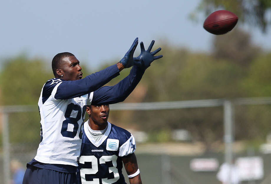 Receiver Dez Bryant (88) reaches for the ball in front of cornerback Brandon Underwood (23) during the afternoon session of the 2013 Dallas Cowboys training camp on Monday, July 22, 2013 in Oxnard. Photo: Kin Man Hui, San Antonio Express-News / ©2013 San Antonio Express-News