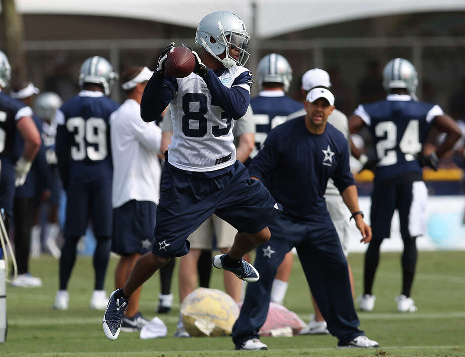 Receiver Terrance Williams (83) makes a catch during the afternoon session of the 2013 Dallas Cowboys training camp on Monday, July 22, 2013 in Oxnard. Photo: Kin Man Hui, San Antonio Express-News / ©2013 San Antonio Express-News