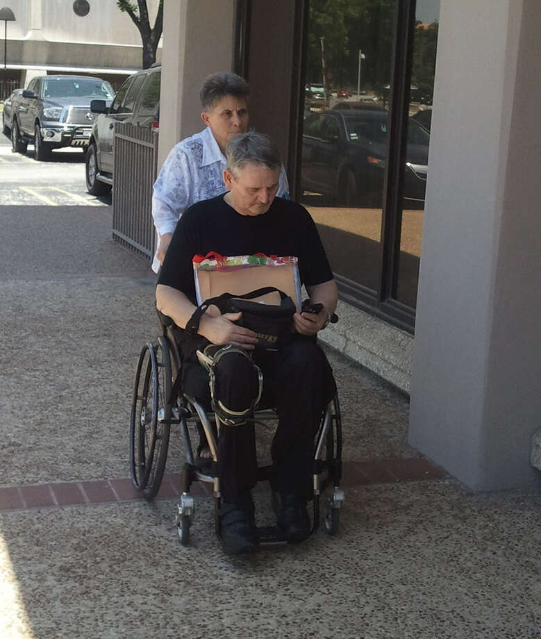 Donald and Sherri Brewer leave court last month. Photo: San Antonio Express-News