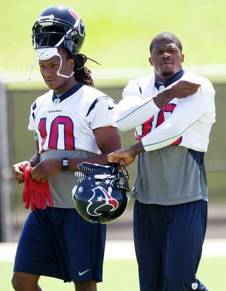 Rookie receiver DeAndre Hopkins, left, will be charged with shifting the attention of opposing defenses off veteran Andre Johnson. Photo: Brett Coomer, Staff / © 2013 Houston Chronicle