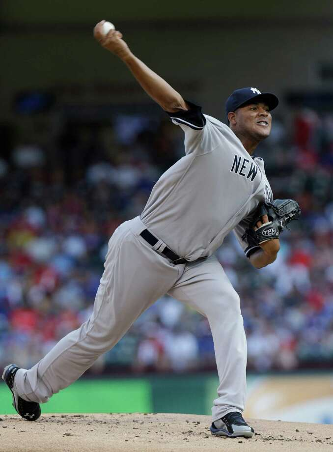 New York Yankees starting pitcher Ivan Nova (47) throws during the first inning of a baseball game against the Texas Rangers Monday, July 22, 2013, in Arlington, Texas. (AP Photo/LM Otero) ORG XMIT: ARL102 Photo: LM Otero / AP