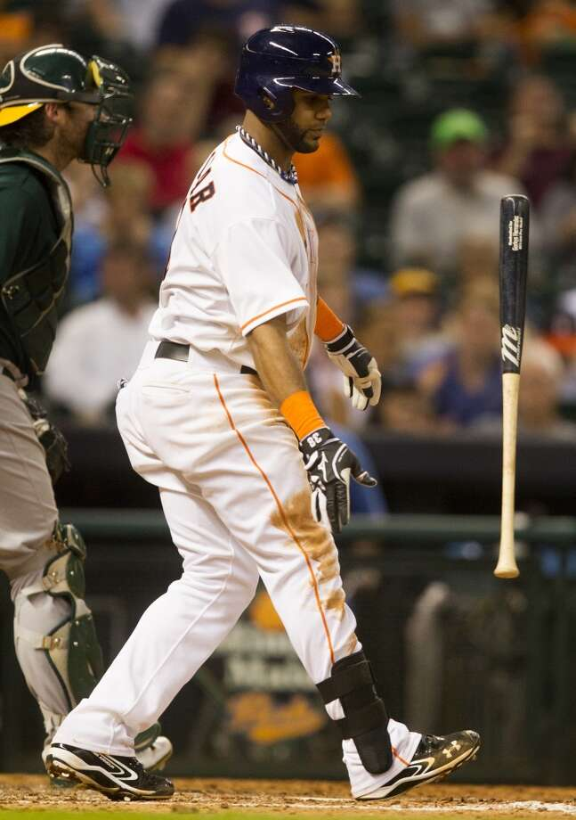 Astros shortstop Jonathan Villar throws his bat after striking out. Photo: J. Patric Schneider, For The Chronicle