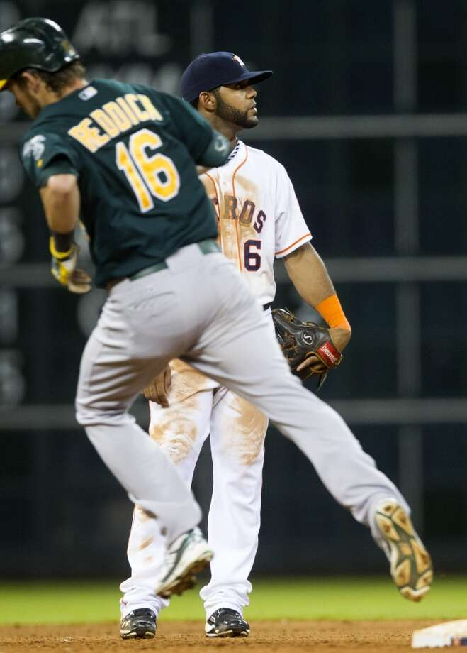 Astros shortstop Jonathan Villar looks at the scoreboard as Josh Reddick of the A's rounds the bases after hitting a home run. Photo: J. Patric Schneider, For The Chronicle
