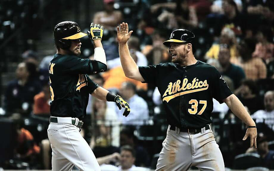 HOUSTON, TX - JULY 22:  Josh Reddick #16 and Brandon Moss #37 of the Oakland Athletics celebrate after Reddick hit a two-run home run in the eighth inning against the Houston Astros at Minute Maid Park on July 22, 2013 in Houston, Texas.  (Photo by Scott Halleran/Getty Images) Photo: Scott Halleran, Getty Images