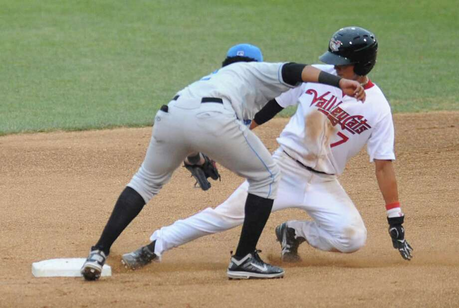 Tri-City ValleyCats runner Chan Moon is safe at second base as he slides under the tag of Hudson Valley Renegades infielder Julian Morillo during a baseball game at Joe Bruno Stadium on Monday July 22, 2013 in Troy N.Y. (Lori Van Buren / Times Union) Photo: Lori Van Buren / 00023166A