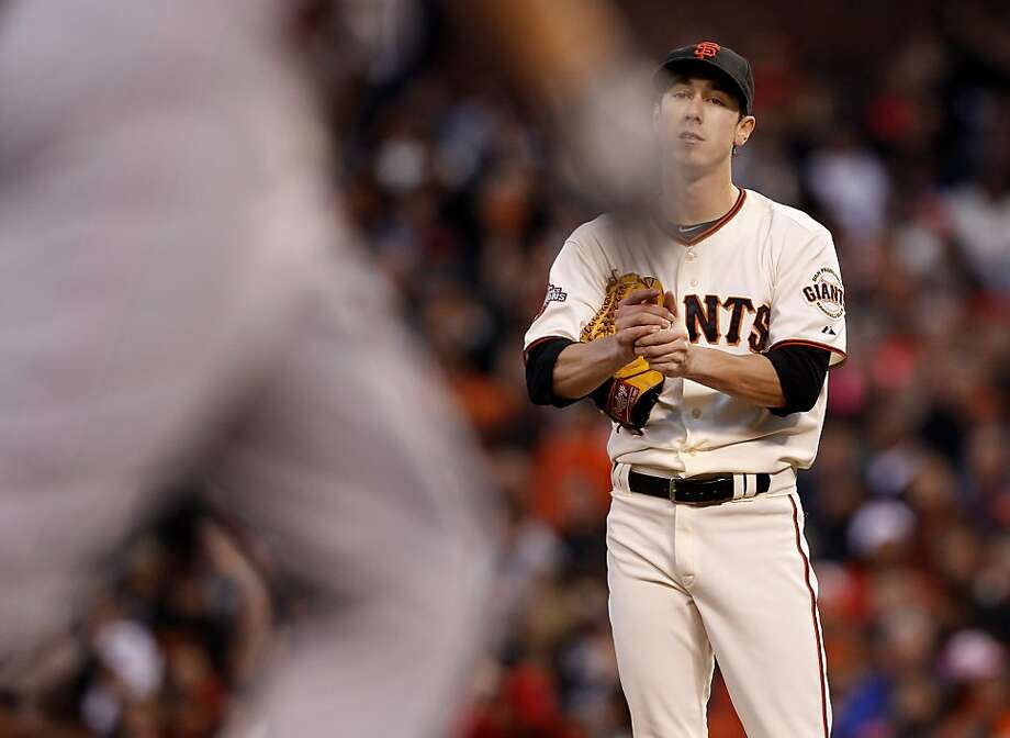 Tim Lincecum watches the Reds' Jay Bruce round the bases after his third-inning homer. Photo: Brant Ward, The Chronicle
