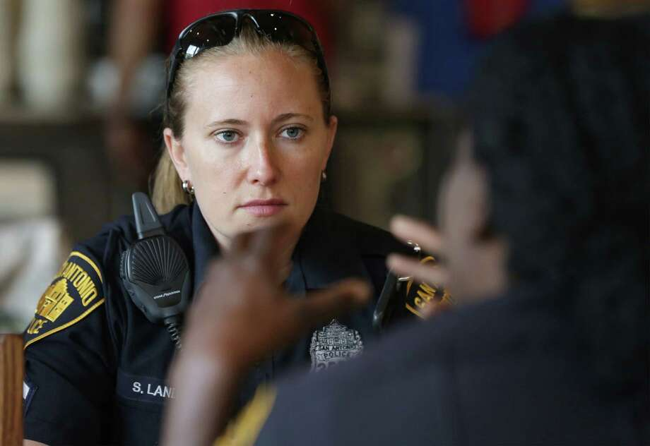 San Antonio Police Detective Stephanie Landry, left, talks with Detective Barbara Thomas, who taught Landry at the training academy, as they stop for lunch during her South Side patrol early shift on Wednesday, July 10, 2013. Photo: San Antonio Express-News / © 2012 San Antonio Express-News