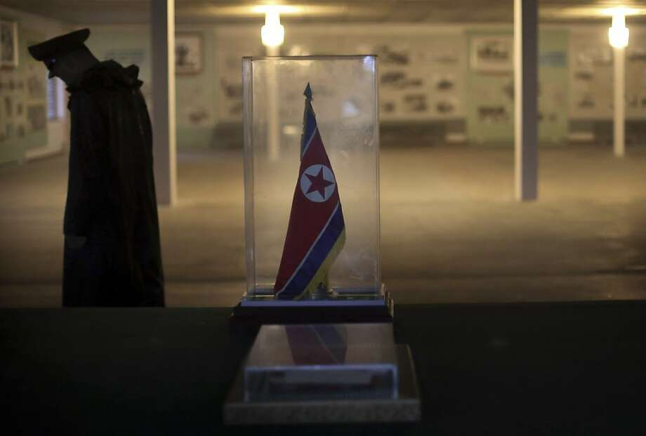 A North Korean soldier walks past a display of the armistice agreement between North and South Korea at the truce village of Panmunjom at the Demilitarized Zone (DMZ) which separates the two Koreas on Monday, July 22, 2013 in North Korea. (AP Photo/Wong Maye-E) Photo: Wong Maye-E, Associated Press