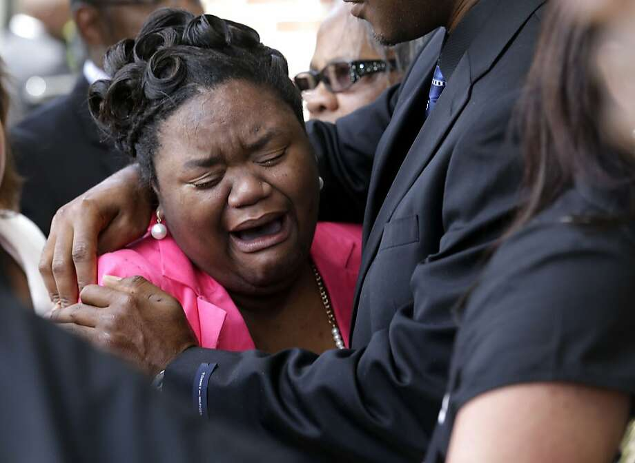 Brandalyn Johnson, the guardian who raised 6-year-old Ahlittia North, whom the child referred to as her mother, cries at the conclusion of Ahlittia's funeral in Gonzales, La., Monday, July 22, 2013. Ahlittia was stabbed to death after disappearing from her mother's suburban New Orleans apartment more than a week ago. Her body was found days later. (AP Photo/Gerald Herbert) Photo: Gerald Herbert, Associated Press