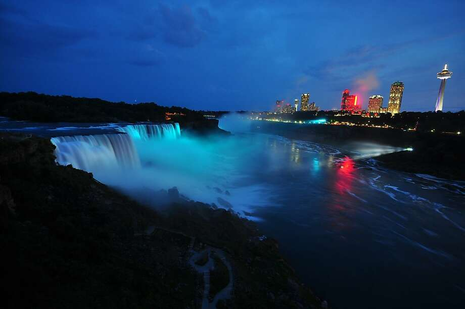 NIAGARA FALLS, NY - JULY 22:  Visitors to Niagara Falls receive notice of the sex of the royal baby indicated by the blue light illuminating the falls in Niagara Falls, New York. The Royal couple,The Duke and Duchess of Cambridge, had a baby boy who was born at 16.24 BST and weighed 8 pounds, 6 ounces. The child, who is now third in line to the throne, has yet to be named.  (Photo by John Normile/Getty Images) Photo: John Normile, Getty Images