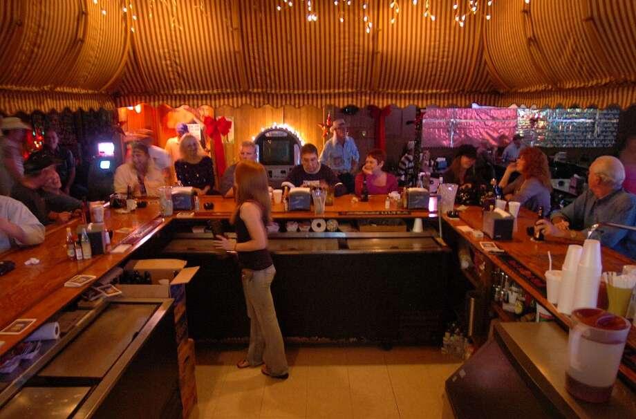 A bartender serves us beers at the Boudain Hut in Port Arthur. Photo taken Sunday, December 4, 2011 Guiseppe Barranco/The Enterprise Photo: Guiseppe Barranco/The Enterprise