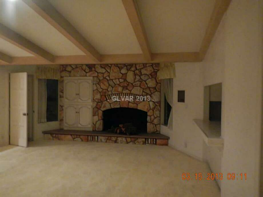 Does that fireplace possibly work? All photos via MLS