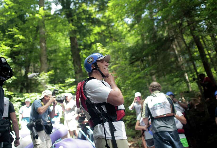 New York Gov. Andrew Cuomo gets ready to face New York City Mayor Michael Bloomberg in the Adirondack Challenge on the Indian River near Indian Lake, N.Y., July 22, 2013. The whitewater rafting race between Cuomo and Bloomberg was held to promote tourism in the Adirondacks. (Nathaniel Brooks/The New York Times)                            ORG XMIT: XNYT19 Photo: NATHANIEL BROOKS, New York Times / NYTNS