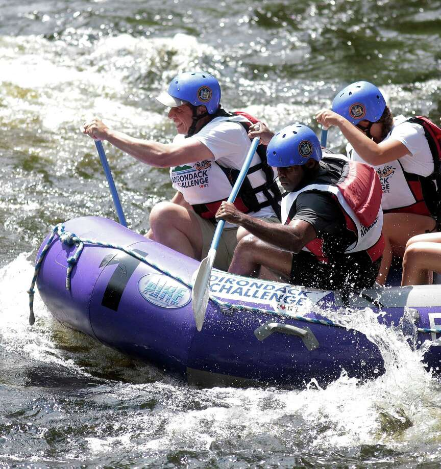 New York Gov. Andrew Cuomo, left, and Alphonso David, the New York special deputy attorney general for civil rights, participate in the Adirondack Challenge on the Indian River near Indian Lake, N.Y., July 22, 2013. The whitewater rafting race between Cuomo and New York Mayor Michael Bloomberg was held to promote tourism in the Adirondacks. (Nathaniel Brooks/The New York Times)                            ORG XMIT: XNYT20 Photo: NATHANIEL BROOKS, New York Times / NYTNS