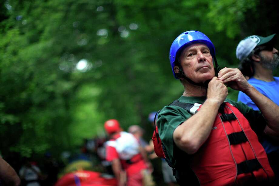 New York Mayor Michael Bloomberg gets ready to participate in the Adirondack Challenge on the Indian River near Indian Lake, N.Y., July 22, 2013. The whitewater rafting race between New York Gov. Andrew Cuomo and Bloomberg was held to promote tourism in the Adirondacks. (Nathaniel Brooks/The New York Times)                            ORG XMIT: XNYT21 Photo: NATHANIEL BROOKS, New York Times / NYTNS