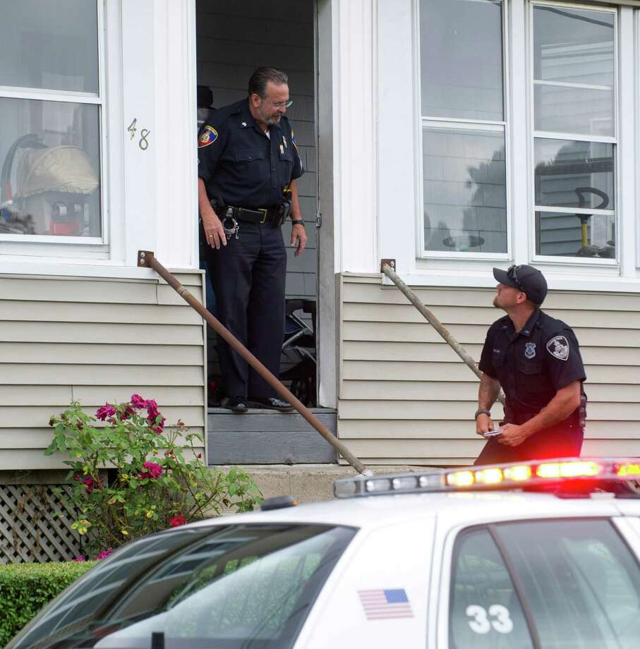 Police work at 48 Manor Street in Stamford, Conn., on Tuesday, July 23, 2013, where a child fell out of a second-floor window. Photo: Lindsay Perry / Stamford Advocate