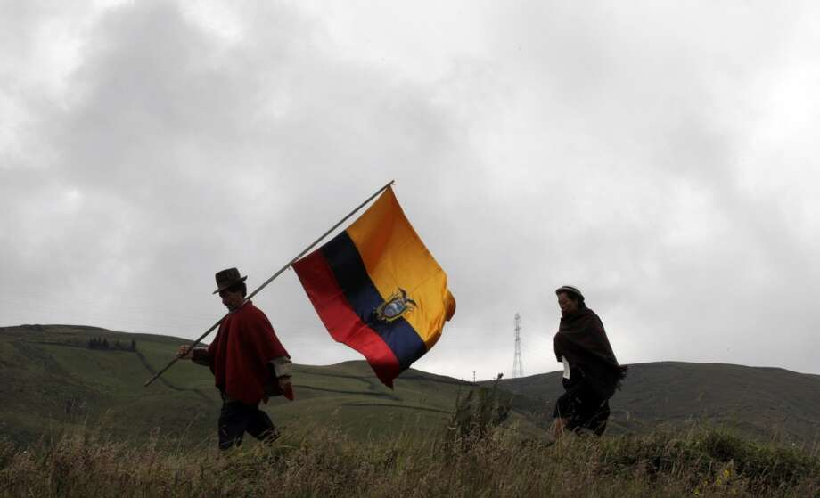11. Ecuador  Jan. - June 2013: $5 billion 2012: $10 billion  [Photo: An indigenous man and woman walk across the highlands with Ecuador's national flag to join a protest against nationwide mining in Chimborazo, Ecuador, Saturday March 17, 2012.] Photo: Dolores Ochoa, Associated Press