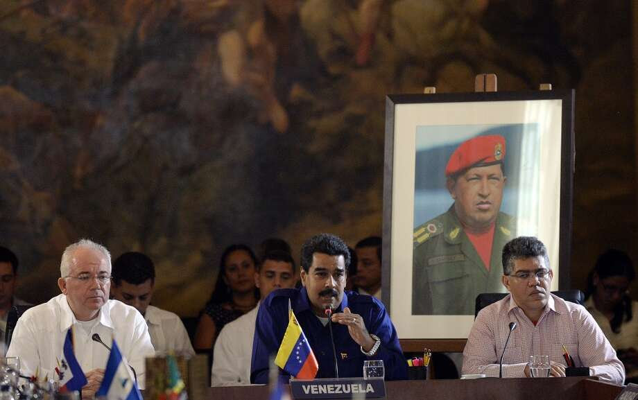 7. Venezuela  Jan. - June 2013: $30 billion 2012: $62 billion  [Photo: Venezuela's President Nicolas Maduro (C), flanked by the country's Minister of Petroleum and Mining and president of the state owned oil company PDVSA, Rafael Ramirez (L) and Foreign Minister Elias Jaua, speaks during the opening of the Petrocaribe Summit, in Caracas on May 5, 2013.] Photo: JUAN BARRETO, AFP/Getty Images